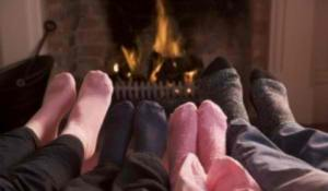 family-feet-in-front-of-fireplace-600x350